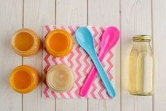 Baby food jars and spoons royalty free stock photo