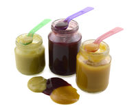 Baby food jars with spoons Royalty Free Stock Images