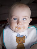 Baby with food on lips Royalty Free Stock Photography