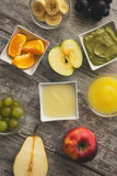 Baby food. Baby mash food. Raw fruits next to puree. Top view Stock Photos