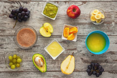 Baby food. Baby mash food. Raw fruits next to puree. Top view Stock Photography