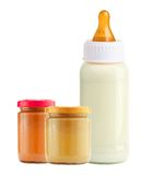 Baby food and and milk bottle isolated on white Royalty Free Stock Photos