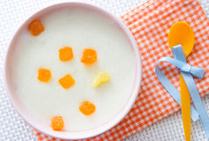 Baby food.Milk porridge with fruits. royalty free stock photo