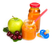 Baby food, pacifier and fruit Royalty Free Stock Photography