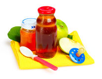 Baby food, pacifier and fruits Royalty Free Stock Photography