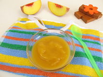 Baby food from peaches for babies and toddlers Stock Images