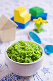 Baby food of peas Royalty Free Stock Images