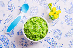 Baby food of peas Stock Images
