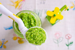 Baby food of peas Stock Photos