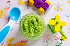 Baby food of peas Stock Photo