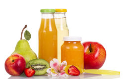 Baby food, puree and fruit juices in glass bottles isolated. Stock Photography