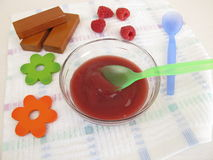 Baby food from raspberries for babies and toddlers Royalty Free Stock Photo