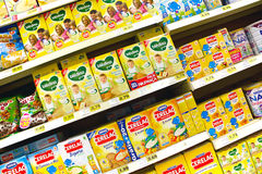 Baby food at the supermarket. A view from several baby food packages at the supermarket shelves - Advertising and promotions concepts Stock Image