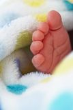 Baby foot in blanket Stock Photos