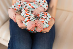 Baby foot in female hands, close-up. Cute little kid leg. Maternity, love, care, new life concept Royalty Free Stock Photo