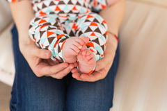 Baby foot in female hands, close-up. Cute little kid leg. Maternity, love, care, new life concept Stock Photography