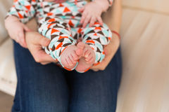Baby foot in female hands, close-up. Cute little kid leg. Maternity, love, care, new life concept Stock Images
