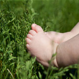 Baby foot on green grass Royalty Free Stock Photo