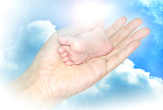 Baby foot in hand Stock Photos