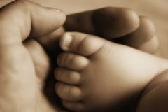 Baby foot in hand Stock Photo