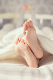 Baby Foot In White Blanket Royalty Free Stock Image