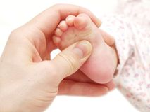 Baby foot massage royalty free stock photos