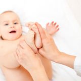 Baby foot massage Stock Image