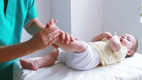 Baby foot massage. Nurse massaging little baby boy foot stock footage