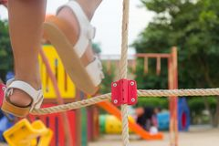 Baby foot Playground rope climbing Royalty Free Stock Image