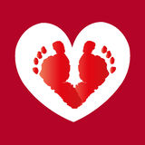 Baby foot prints with heart baby shower greeting card Stock Photography