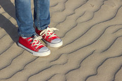 Baby foot on the sea shore. Royalty Free Stock Photo