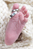 Baby foot with wedding bands Royalty Free Stock Photos