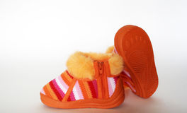 Baby footwear. Orange baby footwear isolated on white Stock Photography