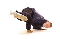 Baby freeze. Breakdancer in dark clothes posing on white background Royalty Free Stock Images