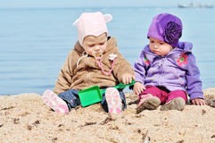 Baby friends on the sea shore Stock Photography