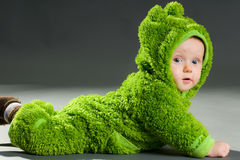 Baby in a frog outfit Royalty Free Stock Images