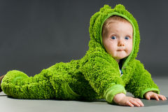 Baby in a frog outfit Royalty Free Stock Photo