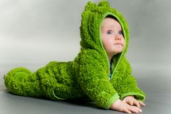 Baby in a frog outfit Stock Photos
