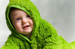 Baby in a frog outfit Stock Photography