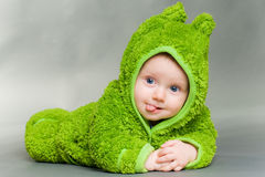 Baby in a frog outfit Royalty Free Stock Photography