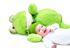 Baby and frog toy Royalty Free Stock Image