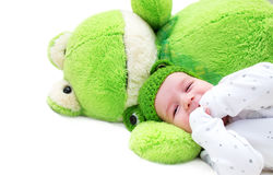 Baby and frog toy Stock Images