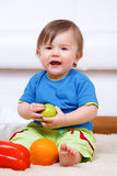 Baby with fruit royalty free stock photography