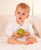 Baby and fruit Stock Photography