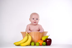 Baby in Fruit Bowl Stock Image