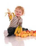Baby with fruits. Royalty Free Stock Photo