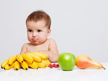 Baby with fruits Stock Images