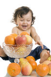 Baby with fruits. Royalty Free Stock Photography