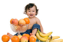 Baby with fruits. Royalty Free Stock Image