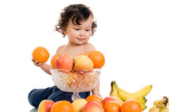 Baby with fruits. Stock Image